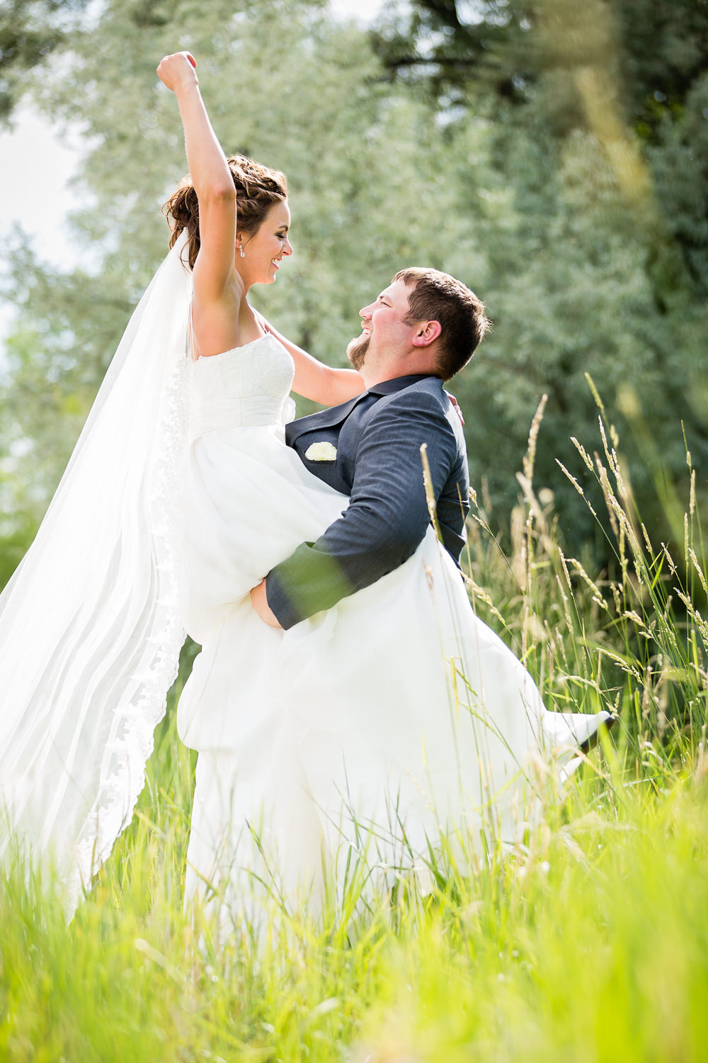 billings-montana-swift-river-ranch-wedding-reception-playful-couple-photo.jpg
