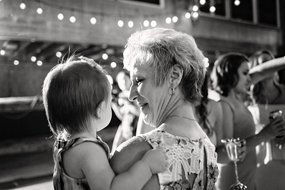 billings-montana-swift-river-ranch-wedding-guest-dancing-with-child.jpg