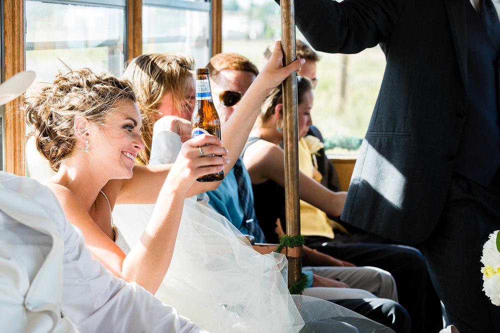 billings-montana-swift-river-ranch-wedding-reception-bride-rides-trolley.jpg