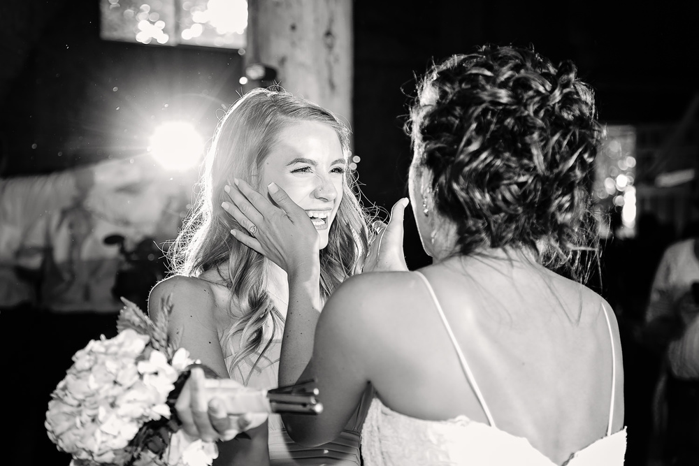 billings-montana-swift-river-ranch-wedding-reception-bride-with-girl-who-caught-bouquet.jpg
