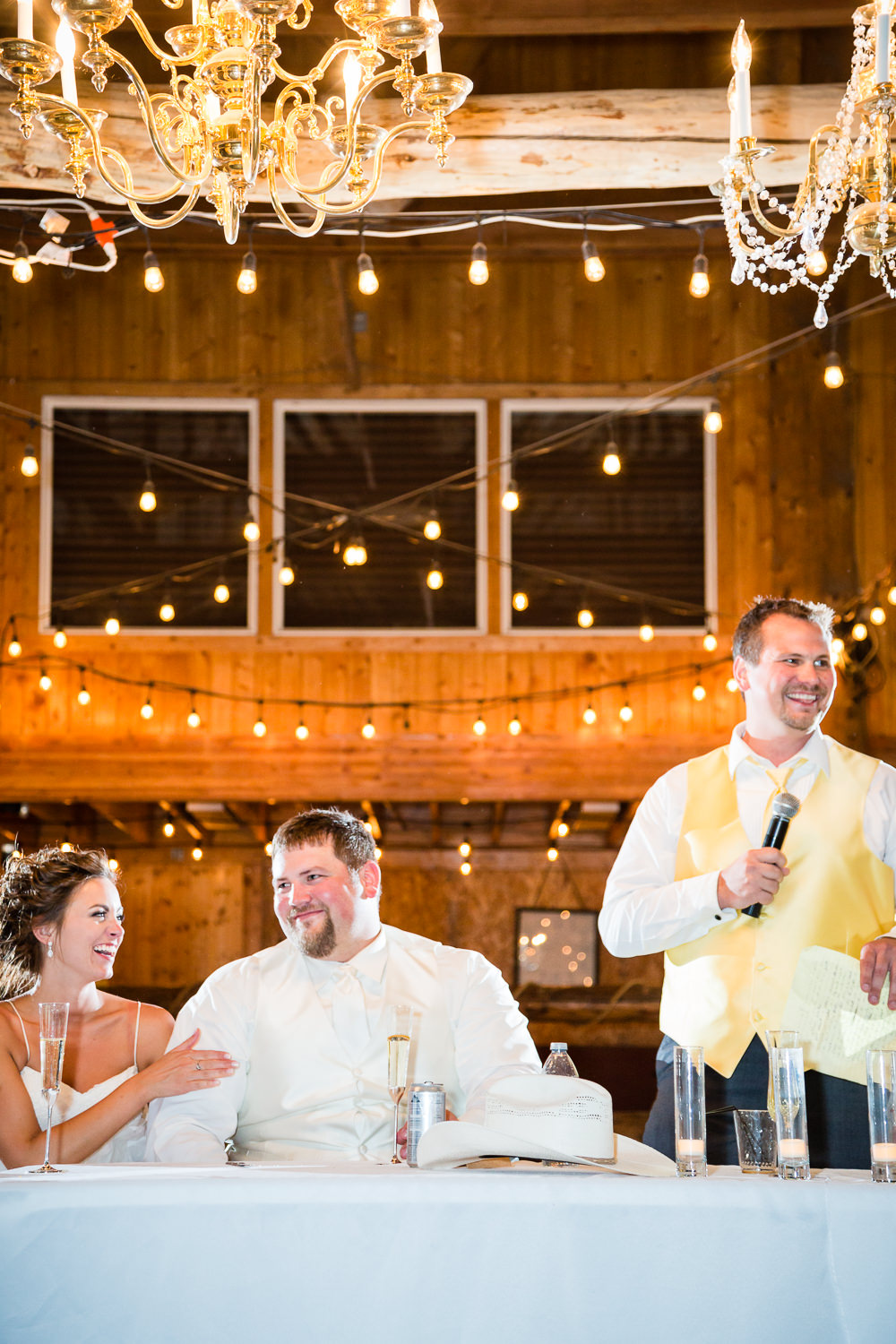 billings-montana-swift-river-ranch-wedding-reception-couple-laughing-during-toast.jpg