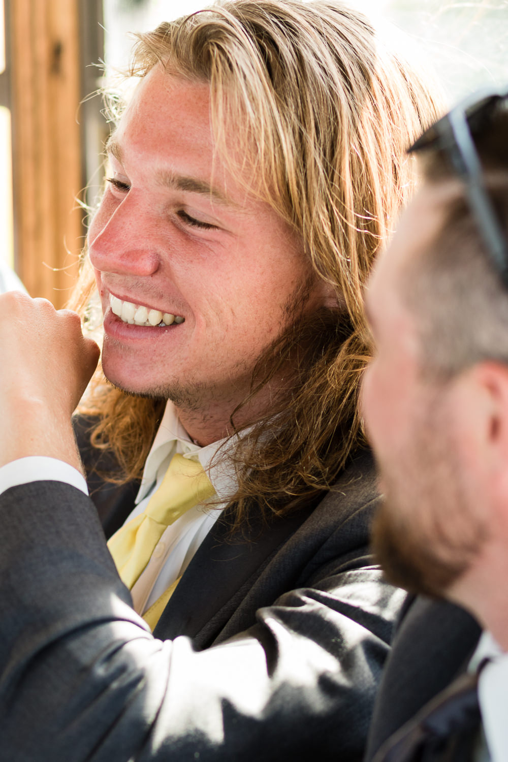 billings-montana-swift-river-ranch-wedding-reception-groomsmen-on-tipsey-trolley.jpg