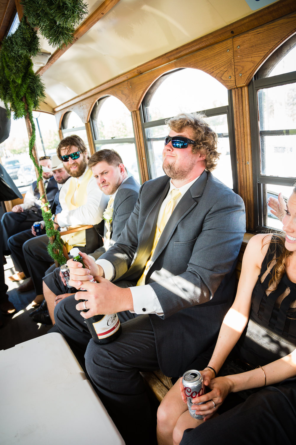 billings-montana-swift-river-ranch-wedding-reception-groomsmen-pops-champagne.jpg