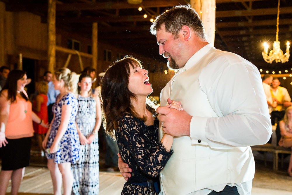 billings-montana-swift-river-ranch-wedding-reception-mother-of-bride-dances-with-groom.jpg