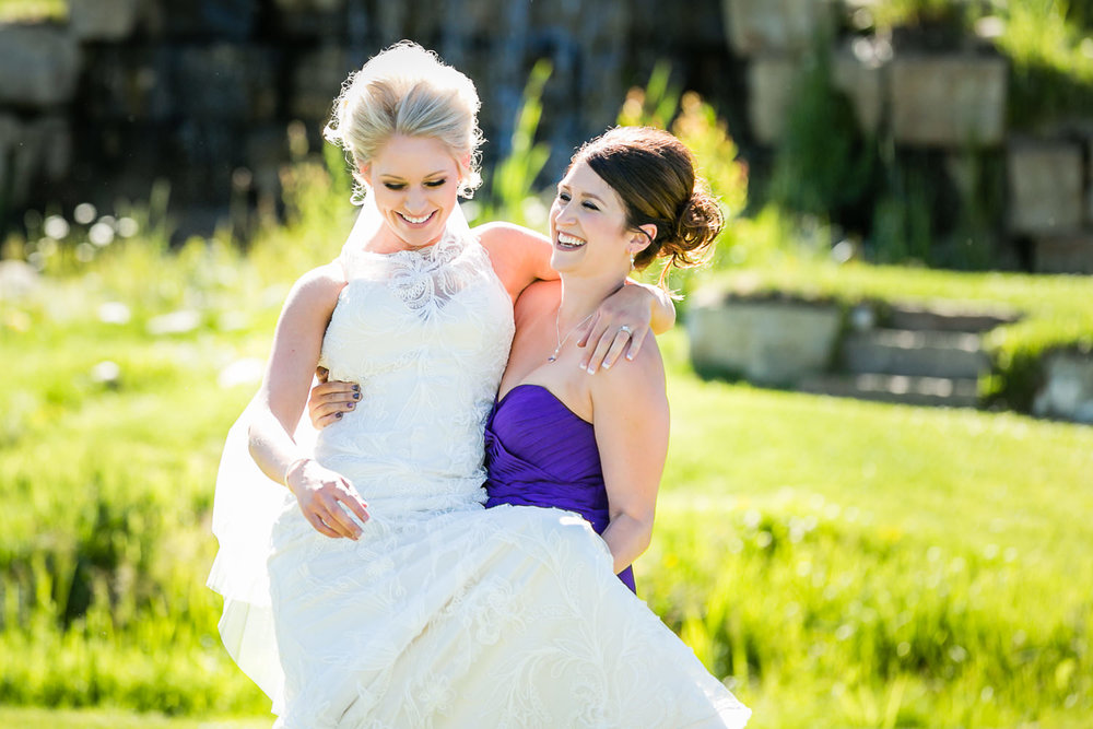 red-lodge-montana-wildflower-wedding-bridesmaid-carries-bride.jpg