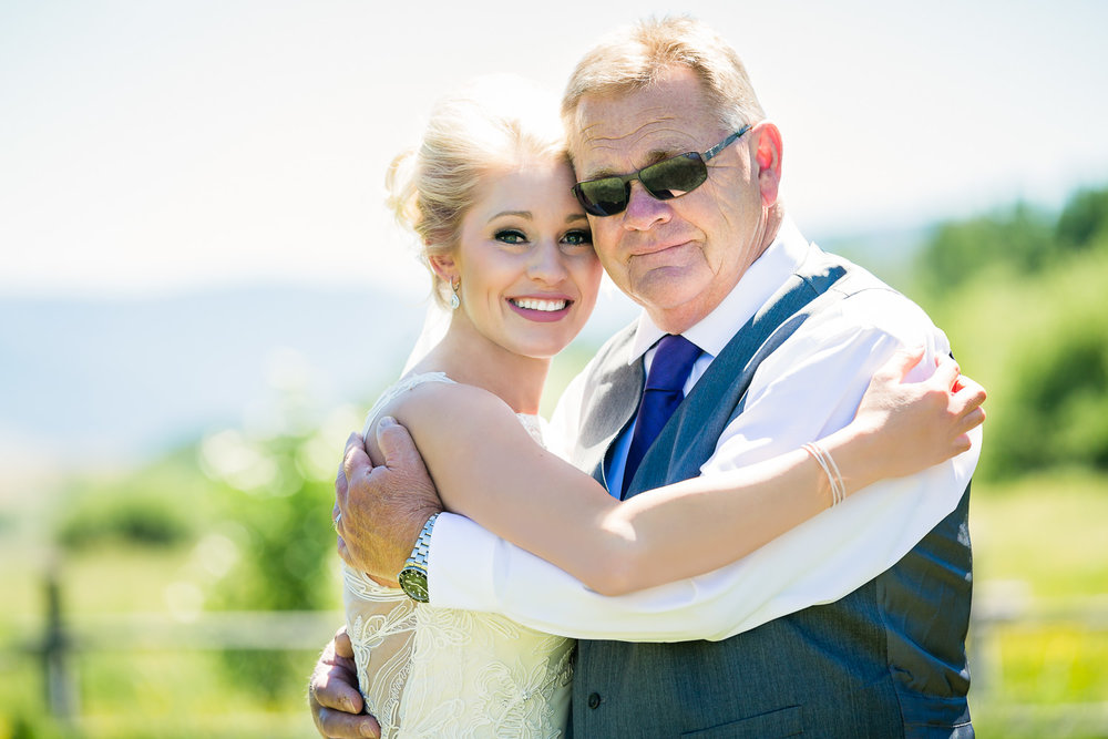 red-lodge-montana-wildflower-wedding-father-daughter-first-look-hug.jpg