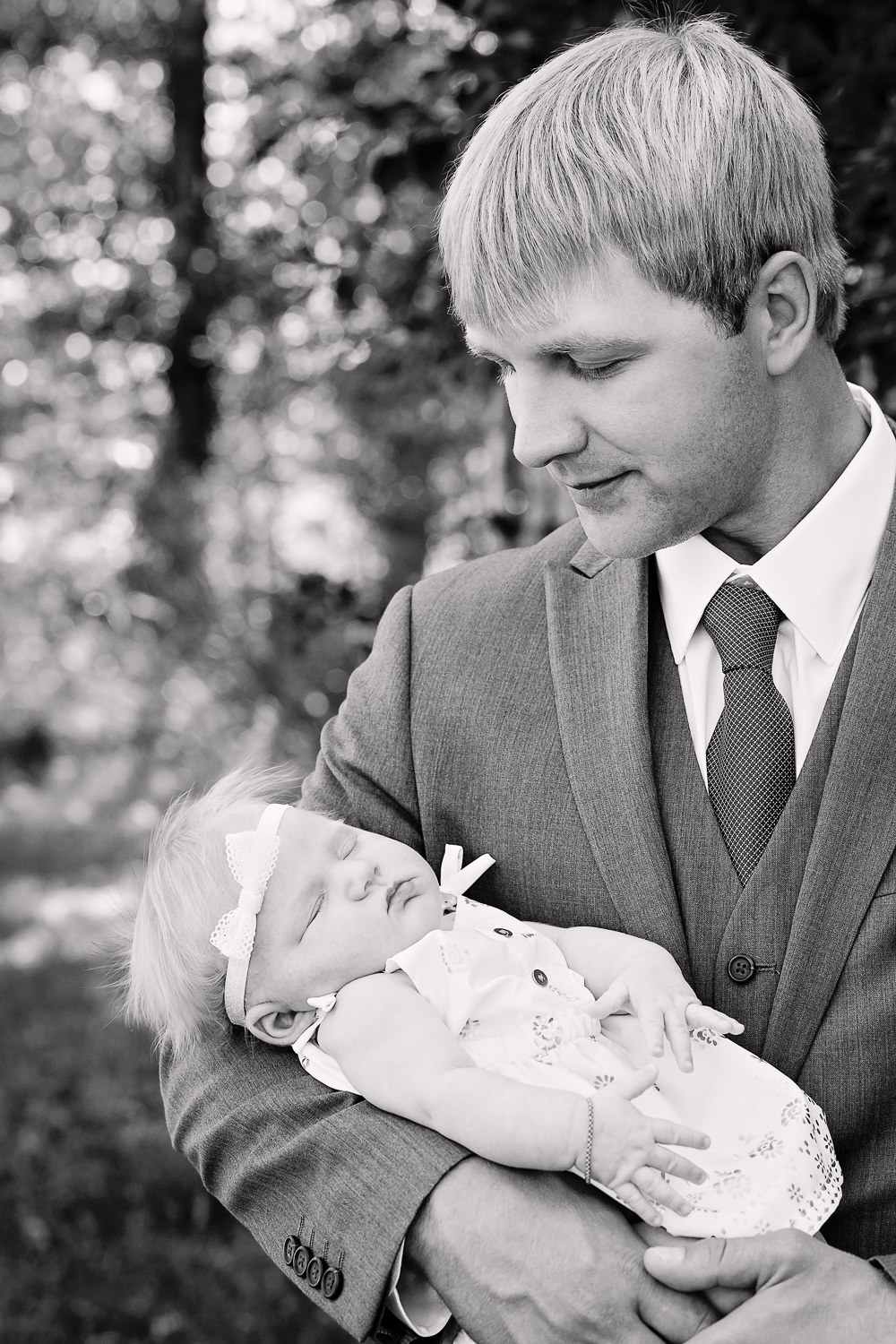 red-lodge-montana-wildflower-wedding-groom-holding-baby-daughter.jpg