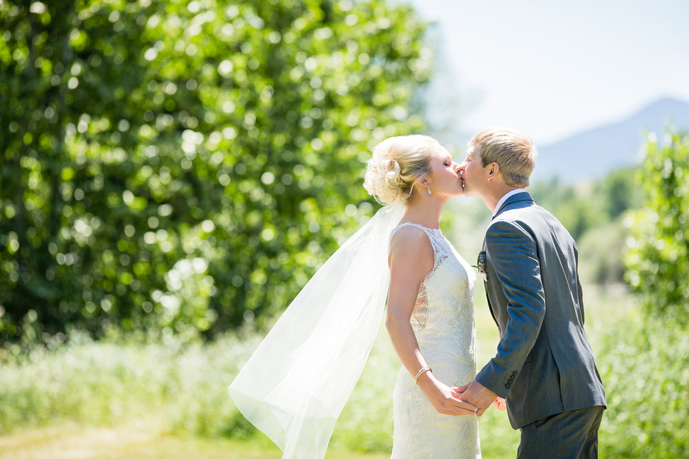 red-lodge-montana-wildflower-wedding-bride-groom-kiss-first-look.jpg
