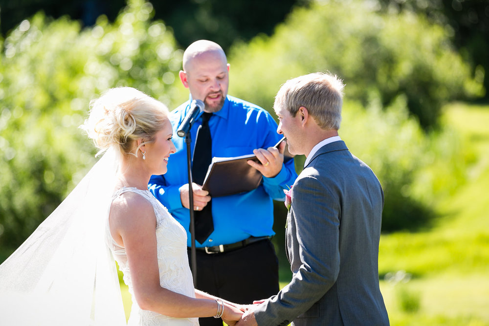 red-lodge-montana-wildflower-wedding-bride-groom-laughing-during-ceremony.jpg