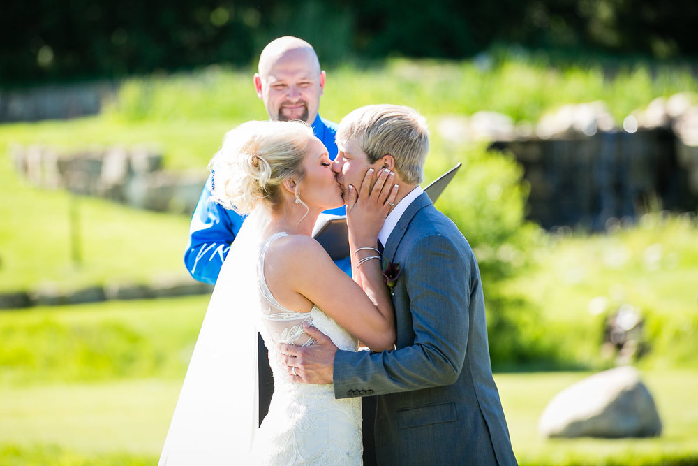 red-lodge-montana-wildflower-wedding-ceremony-kiss.jpg