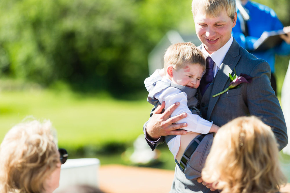 red-lodge-montana-wildflower-wedding-father-hugs-son-during-ceremony.jpg