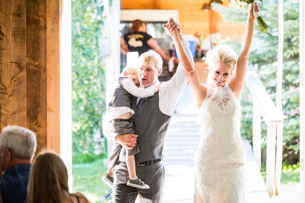 red-lodge-montana-wildflower-wedding-bride-groom-son-enter-reception.jpg