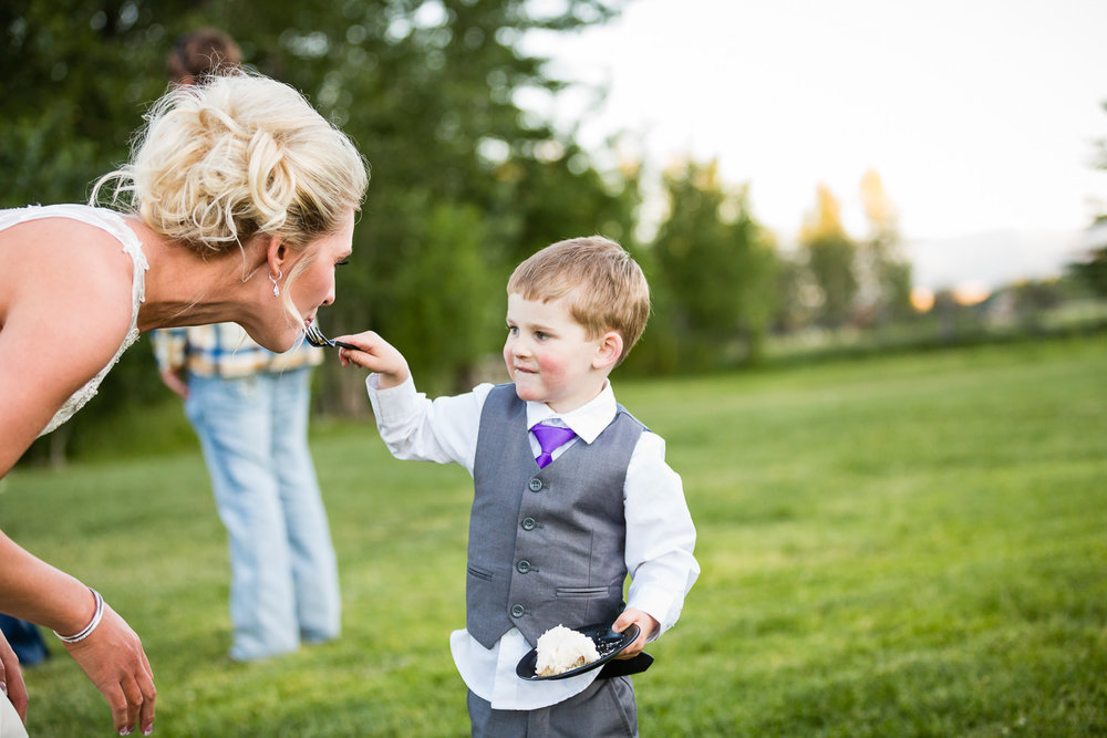 red-lodge-montana-wildflower-wedding-son-feeds-mom-cake.jpg