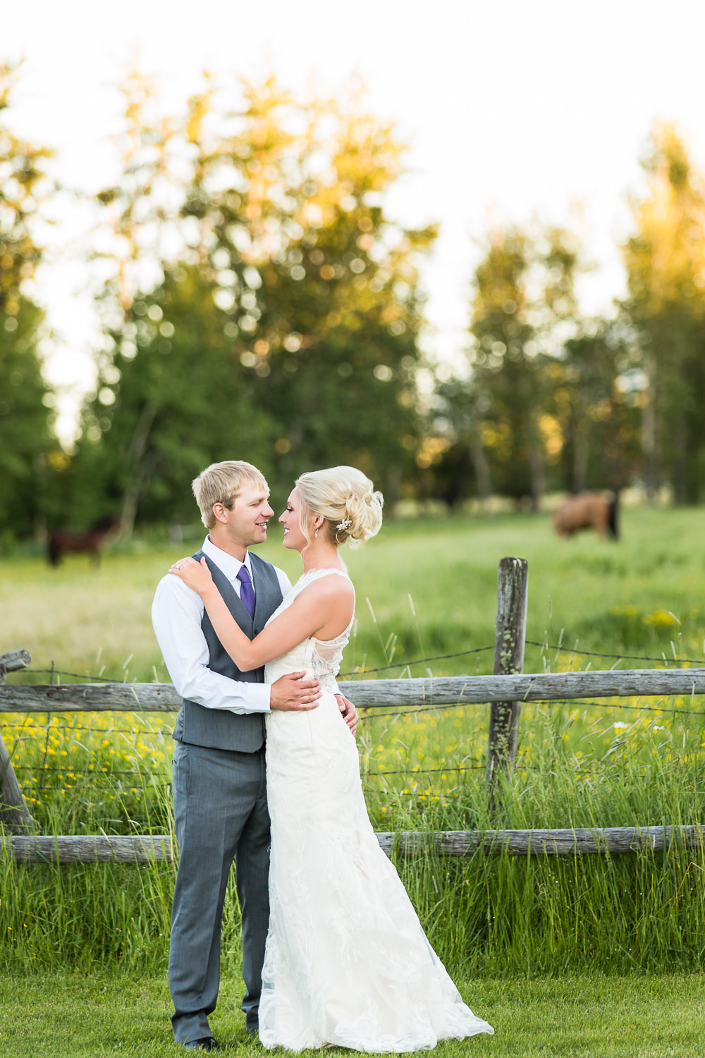 red-lodge-montana-wildflower-wedding-couple-against-fence.jpg