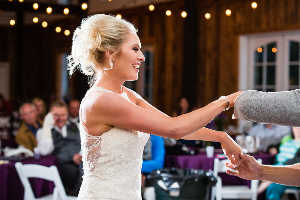 red-lodge-montana-wildflower-wedding-bride-dances-at-reception.jpg
