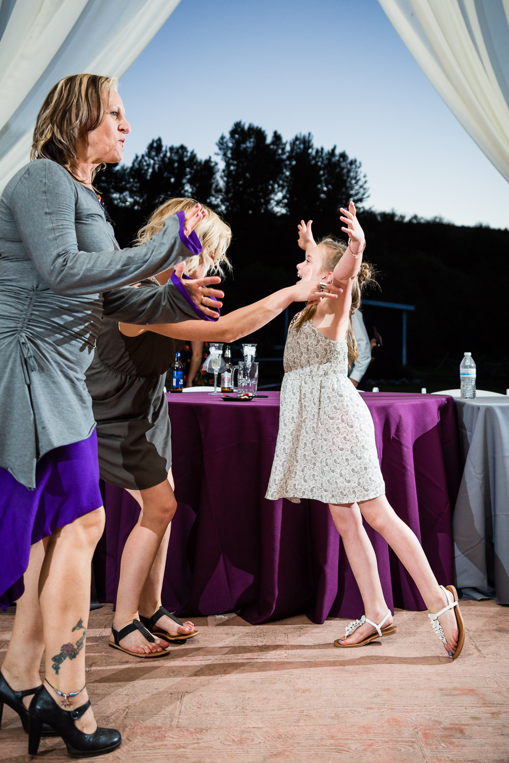 red-lodge-montana-wildflower-wedding-daughter-leaps-mother-reception.jpg