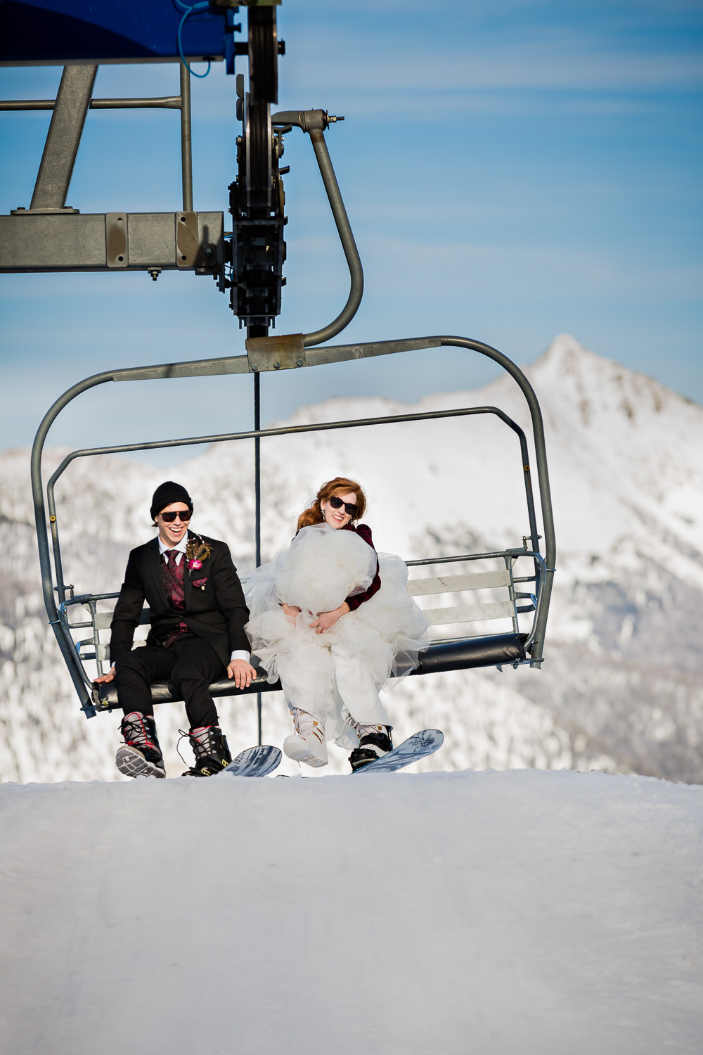big-sky-montana-wedding-big-sky-resort-bride-groom-unload-lift.jpg