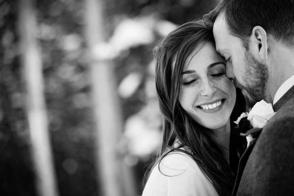 big-sky-montana-wedding-winter-wedding-groom-nuzzles-giggling-bride.jpg
