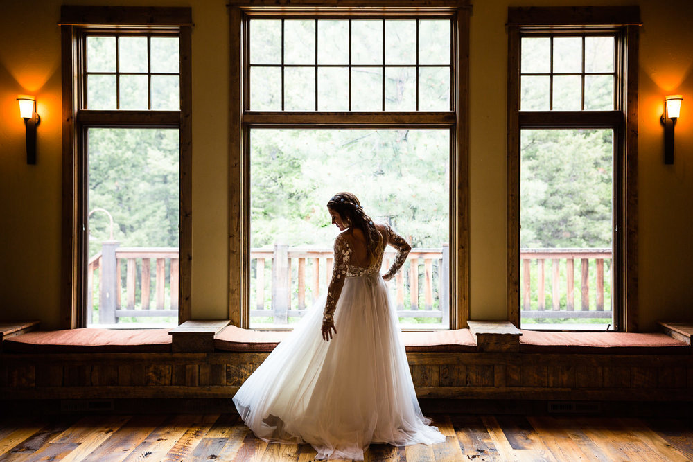 bozeman-montana-wedding-bride-admires-dress.jpg