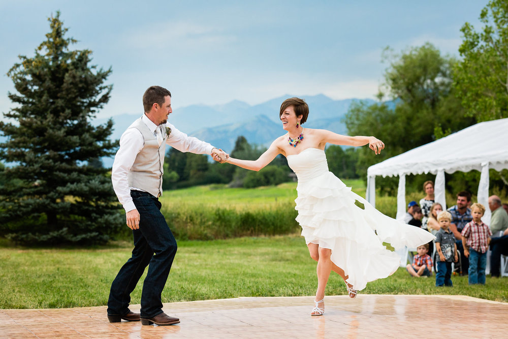 bozeman-montana-wedding-bride-groom-first-dance-against-bridgers.jpg