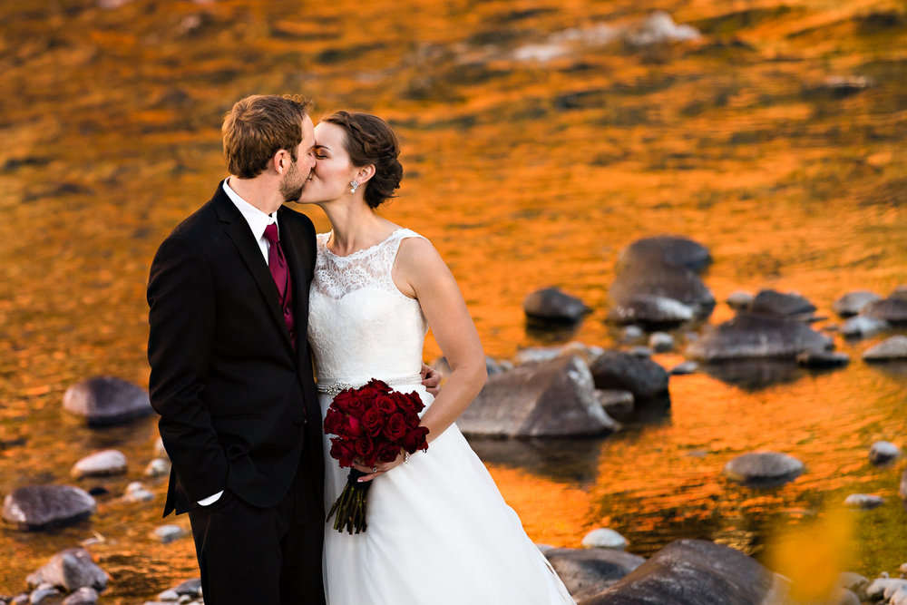 absarokee-beartooth-wilderness-wedding-kiss-along-river.jpg
