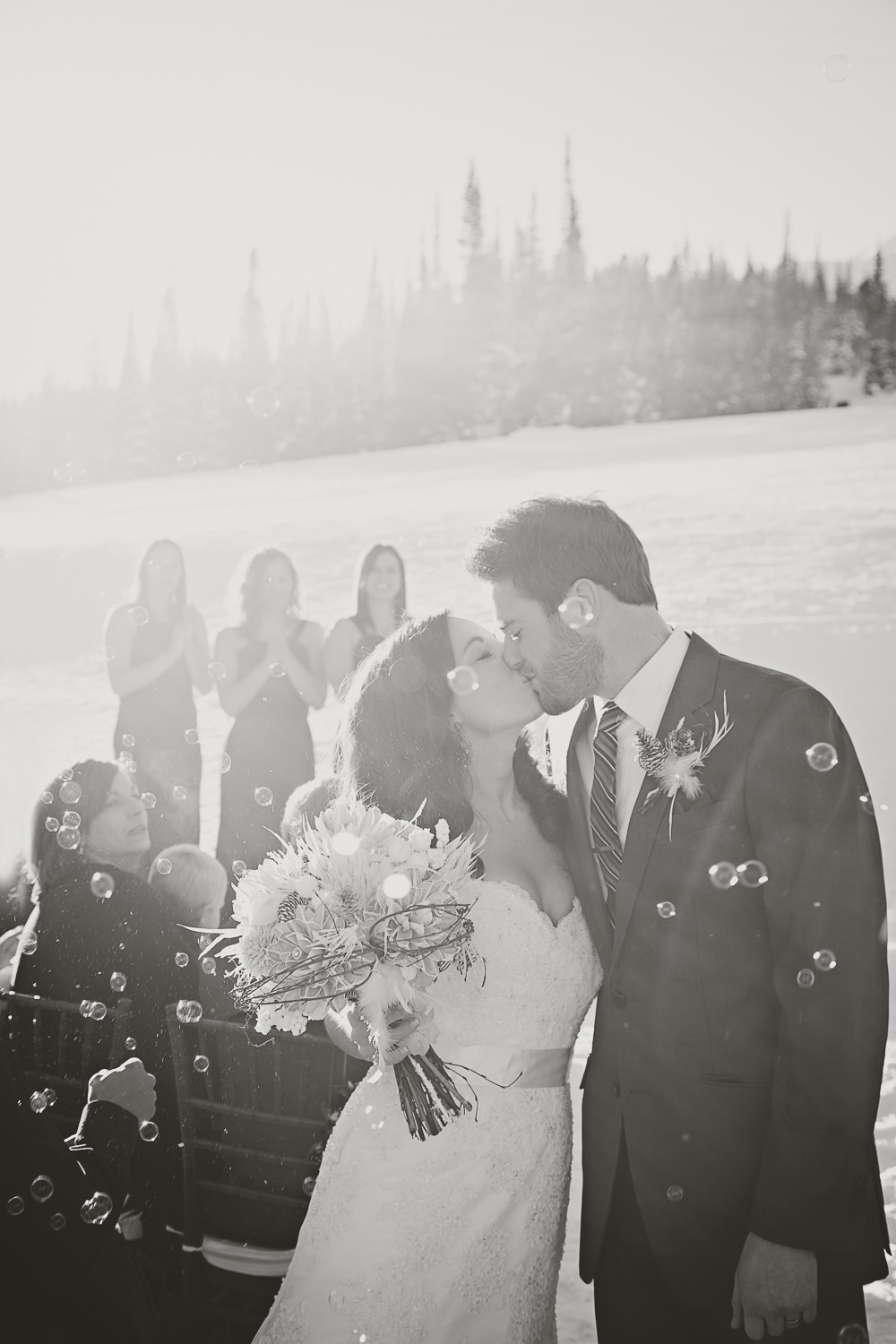 big-sky-resort-weddings-recessional-couple-kiss.jpg