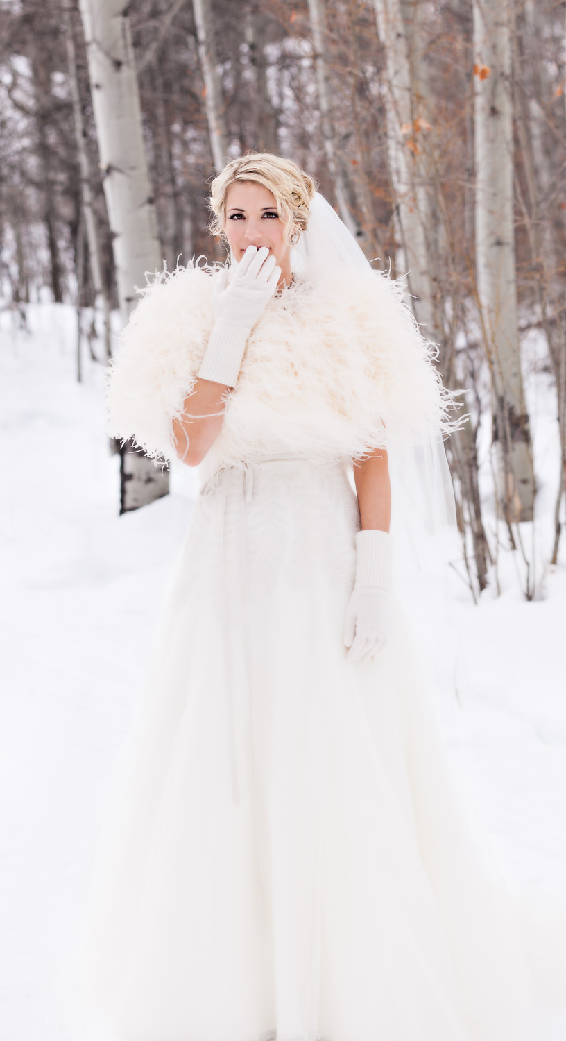 big-sky-winter-wedding-bride-hand-on-mouth.jpg