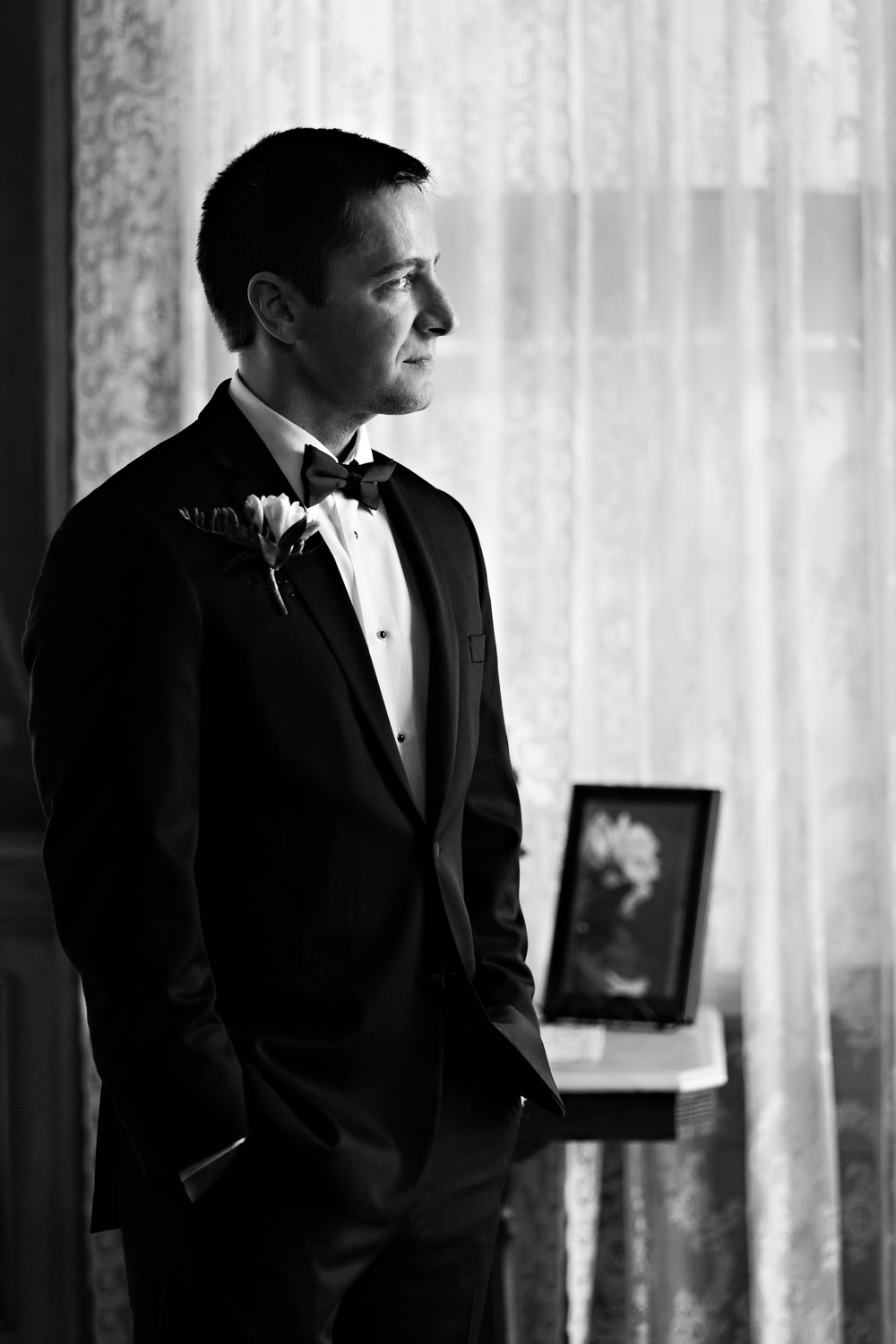 billings-montana-wedding-moss-mansion-groom-posing.jpg