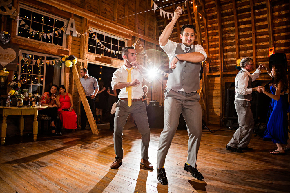 bozeman-wedding-big-yellow-barn-groom-best-man-dancing.jpg