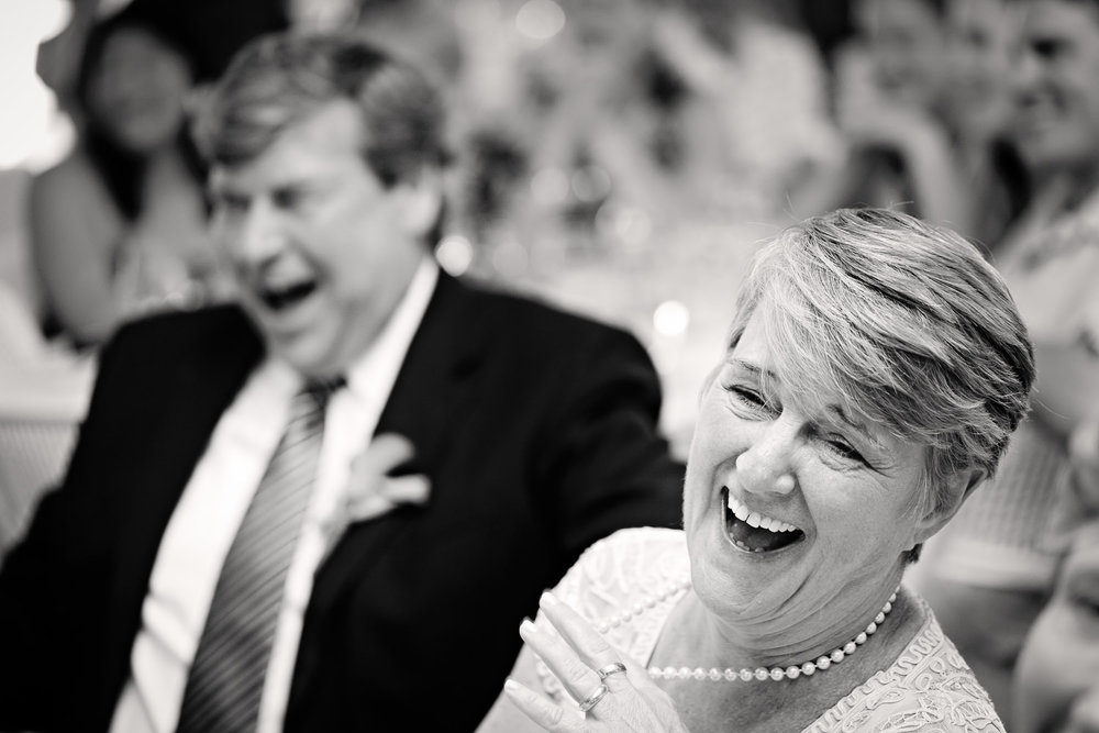 bozeman-wedding-hart-ranch-grooms-parents-laughing.jpg