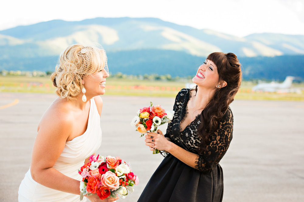 missoula-wedding-flight-museum-bride-maid-laughing.jpg