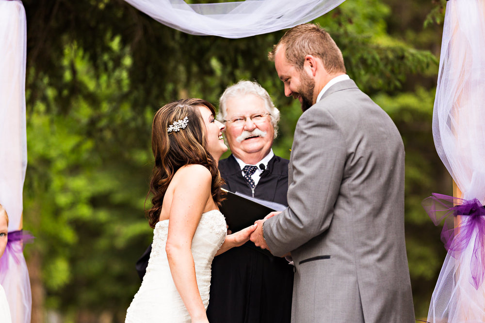 red-lodge-wedding-rock-creek-resort-ceremony-exchanging-rings.jpg