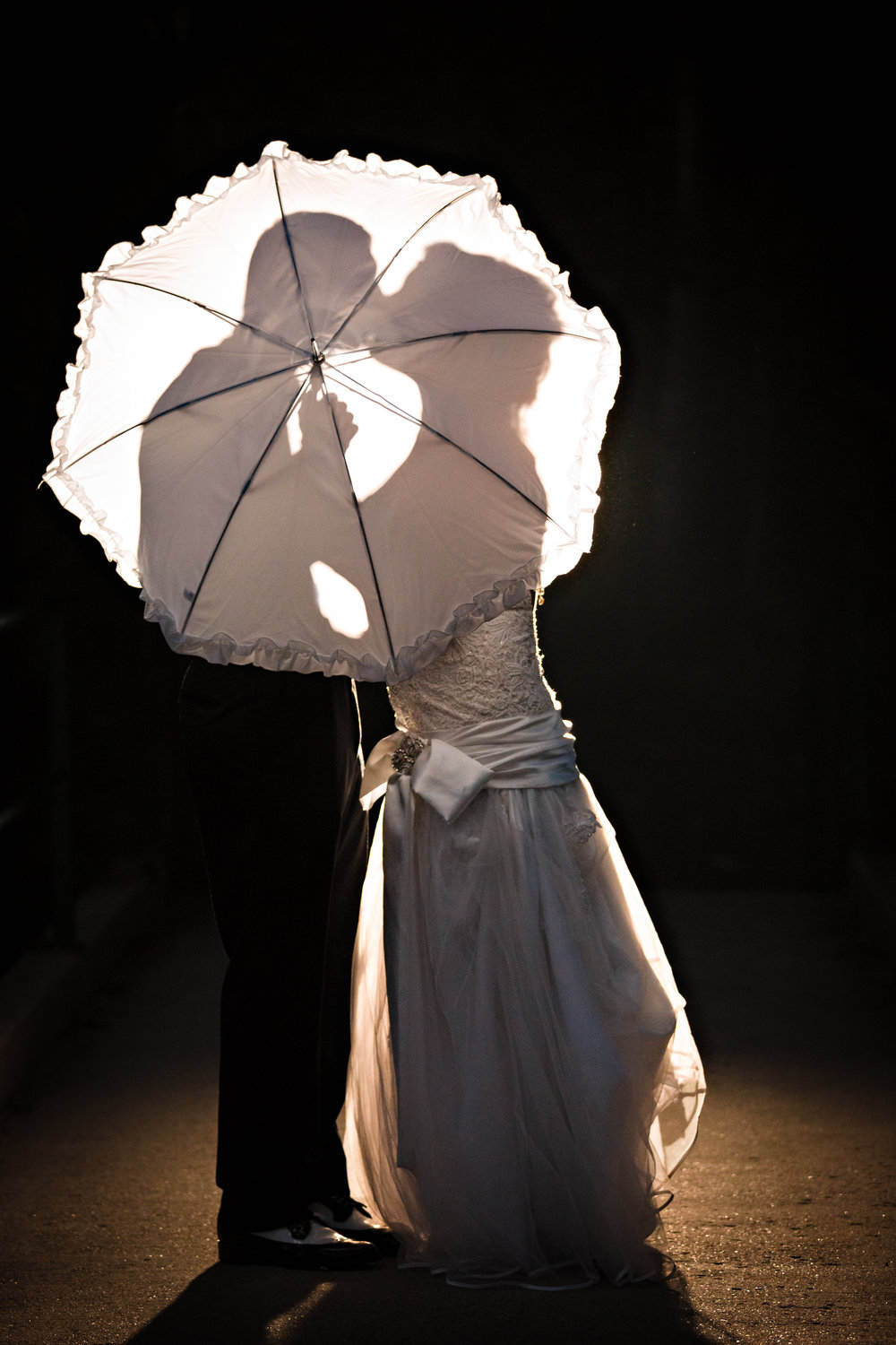 red-lodge-wedding-rock-creek-resort-bride-groom-under-umbrella.jpg
