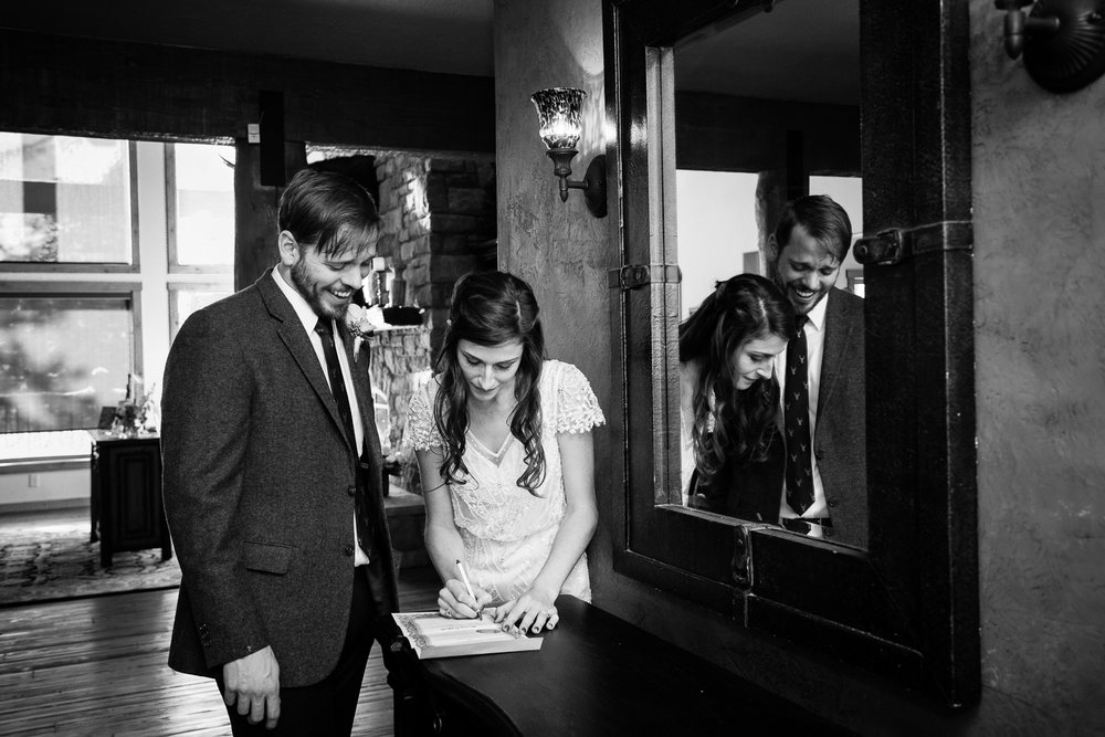 big-sky-montana-wedding-winter-wedding-bride-groom-signing-marriage-license.jpg