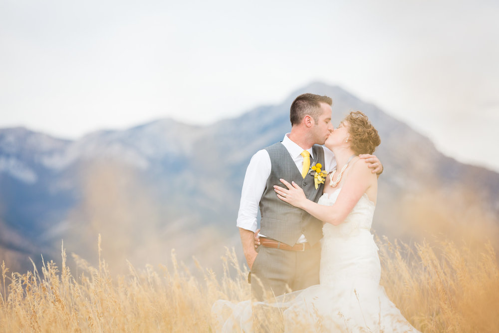 bozeman-wedding-big-yellow-barn-couple-against-bridger-mountains.jpg