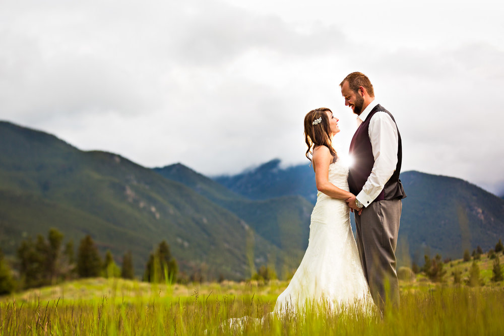 red-lodge-wedding-rock-creek-resort-couple-against-beartooth-mountains.jpg
