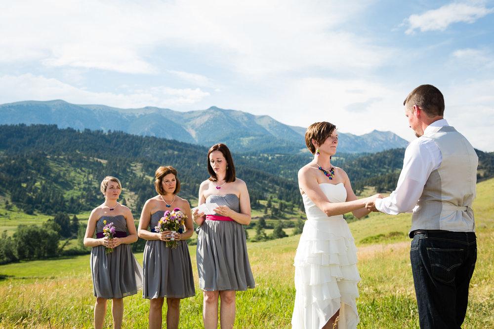 bozeman-montana-wedding-bride-groom-during-ceremony-reading.jpg