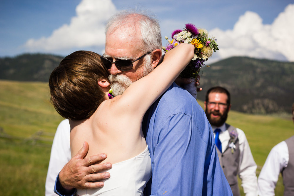bozeman-montana-wedding-bride-hugs-father-at-altar.jpg