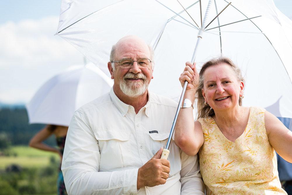 bozeman-montana-wedding-guests-enjoying-umbrella-shade.jpg