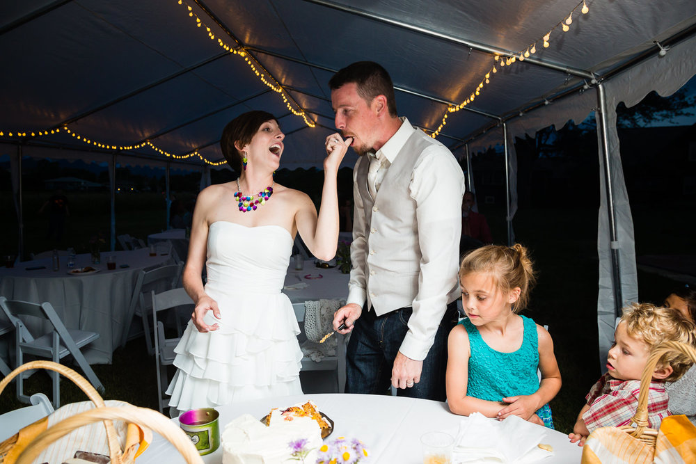 bozeman-montana-wedding-bride-feeds-groom-cake.jpg