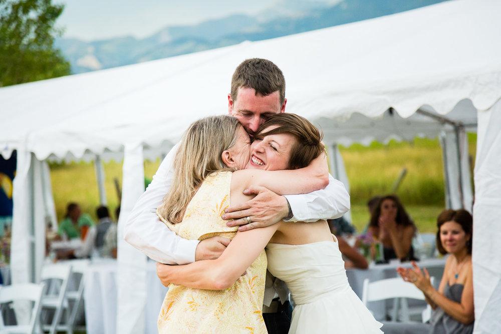 bozeman-montana-wedding-bride-groom-hug-mom.jpg