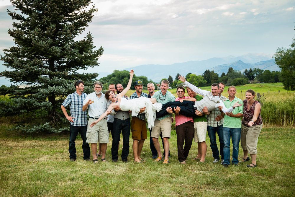 bozeman-montana-wedding-friends-lift-bride-and-groom.jpg