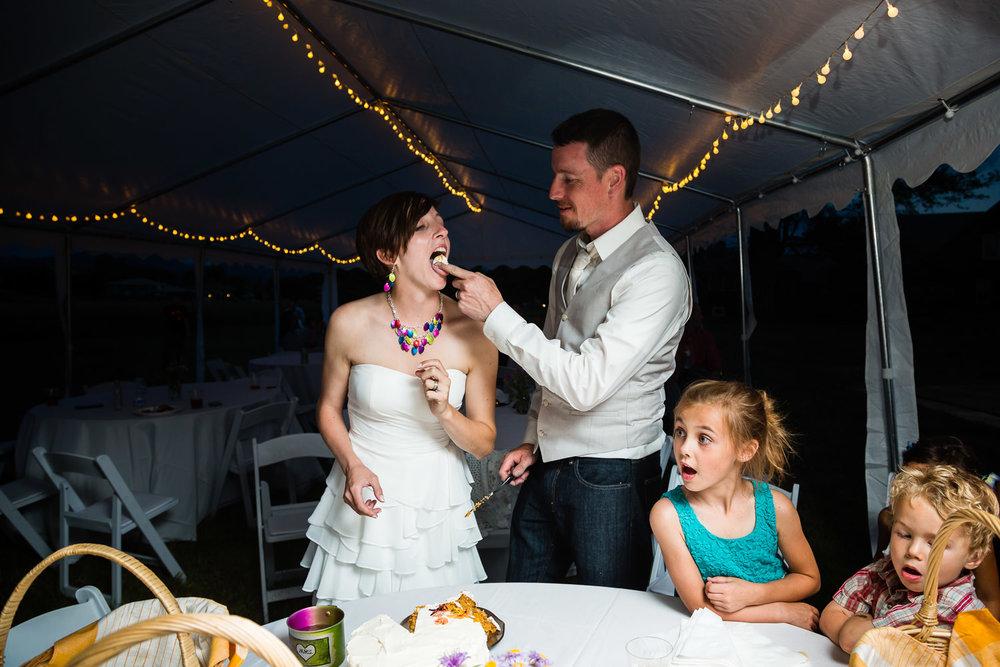 bozeman-montana-wedding-groom-feeds-bride-cake.jpg