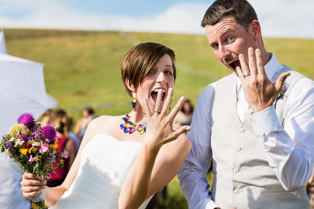 bozeman-montana-wedding-bride-groom-showoff-rings.jpg