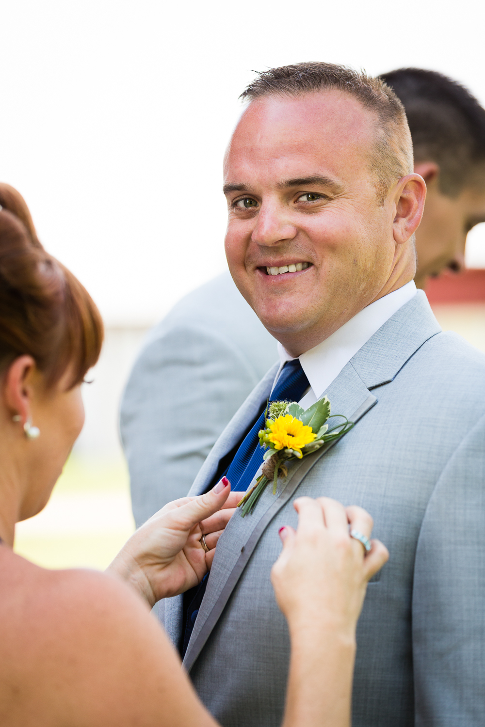 bozeman-montana-wedding-roys-barn-best-man-receives-flowers.jpg