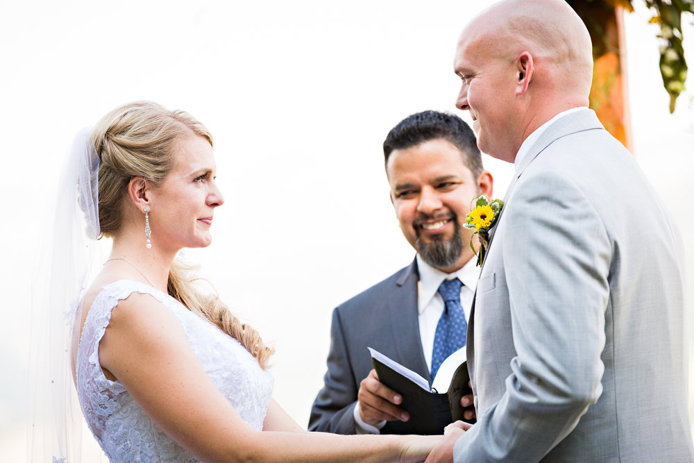 bozeman-montana-wedding-roys-barn-bride-grrom-laugh-during-ceremony.jpg