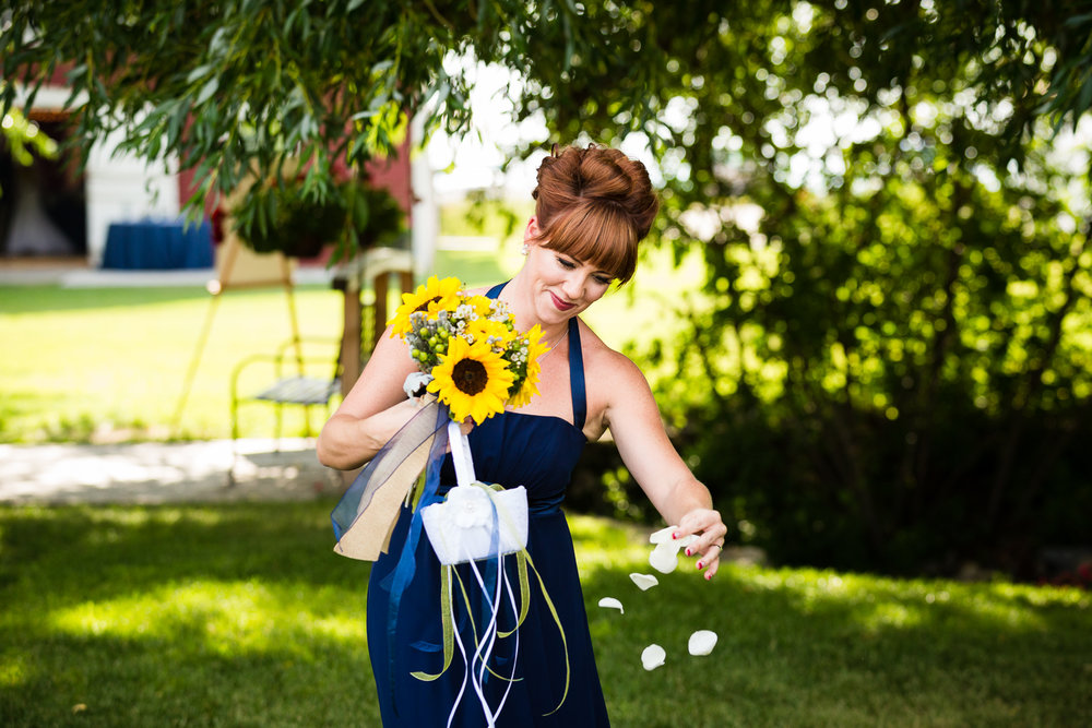 bozeman-montana-wedding-roys-barn-bridesmaid-sprinkles-flower-petals.jpg