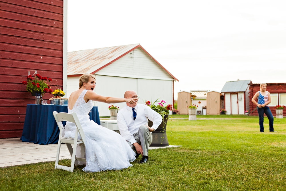 bozeman-montana-wedding-roys-barn-bride-during-garter-toss.jpg