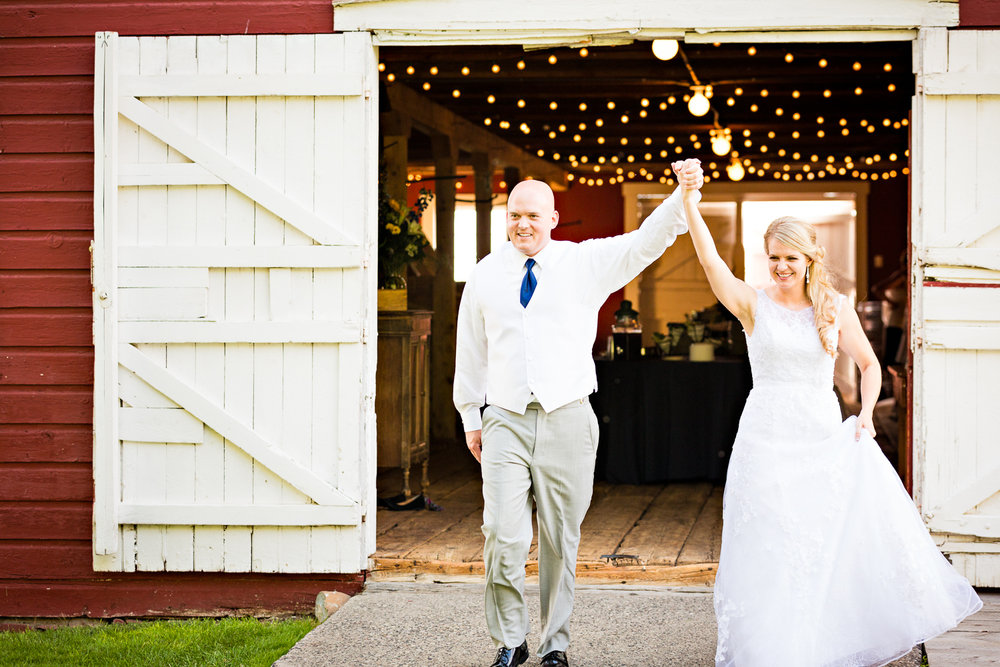 bozeman-montana-wedding-roys-barn-bride-groom-enter-reception.jpg