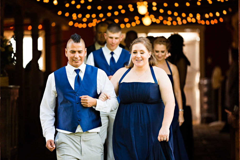 bozeman-montana-wedding-roys-barn-bridemaid-groomsmen-enter-reception.jpg